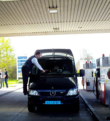 The Mercedes Sprinter stops at a gas station