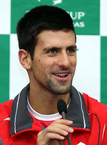 Serbian Davis Cup tennis player Novak Djokovic smiles during a media conference in Belgrade