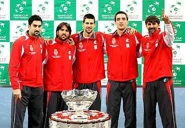 Members of Serbian tennis team Nenad Zimonjic, Janko Tipsarevic, Novak Djokovic, Viktor Troicki and team captain Bogdan Obradovic pose with the Davis Cup trophy after the official draw at Belgrade Arena
