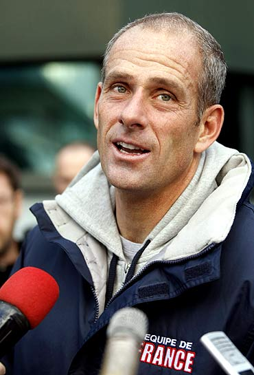 French Davis Cup team captain Guy Forget speaks to reporters after a team training session in Belgrade