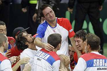 Serbia's Viktor Troicki celebrates after beating France's Michael Llodra during their Davis Cup final match in Belgrade