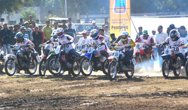 Motorcyclists shoot out from the gates in the Local Class race