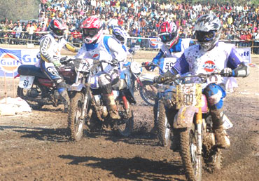 Bikers race in the Private Expert Class