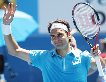 Roger Federer waves to the crowd after winning against Albert Montanes.