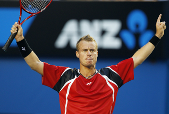 Lleyton Hewitt waves to the crowd after his opponent Marcos Baghdatis retired from the match.