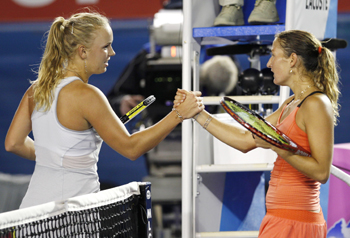 Caroline Wozniacki shakes hands with Shahar Peer.