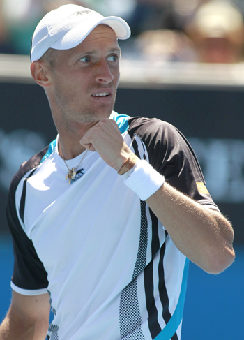 Nikolay Davydenko reacts after winning against Juan Monaco.