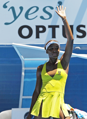Venus Williams waves after defeating Italy's Francesca Schiavone