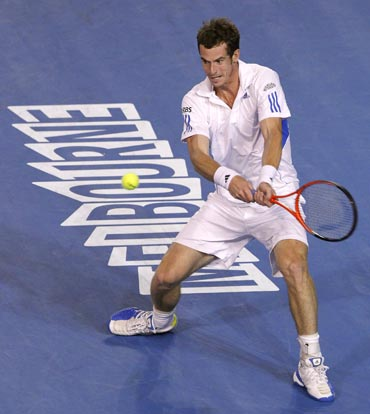 Andy Murray in action against Roger Federer