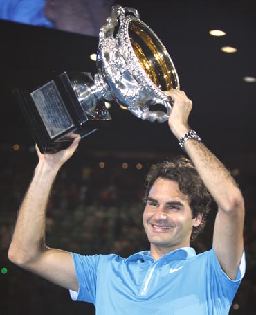 Roger Federer with the winners trophy