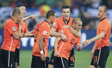 Netherlands' Wesley Sneijder celebrates his goal with team mates including Robin van Persie and Andre Ooijer during their quarter-final against Brazil in Port Elizabeth