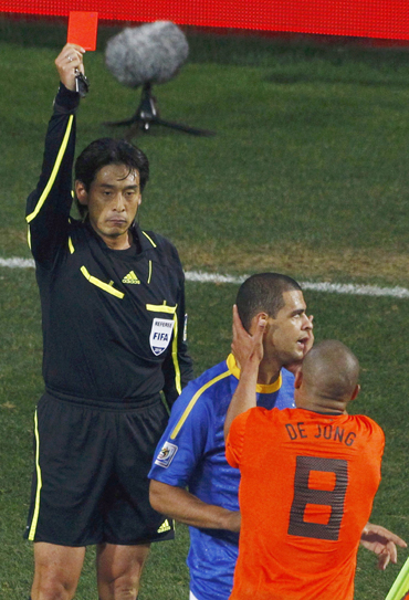 Referee Yuichi Nishimura of Japan shows the red card to Brazil's Felipe Melo (C) during their 2010 World Cup quarter-final soccer match in Port Elizabeth