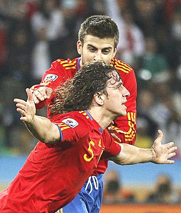 Carles Puyol (front) celebrates with teammate Gerrard Pique after scoring against Germany