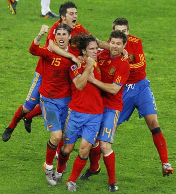 Spanish players celebrate with Puyol (centre)