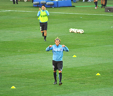 Diego Forlan acknowledges the crowd as he warms up before the South Korea match