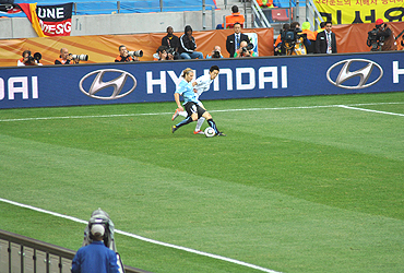 Diego Forlan in action against South Korea