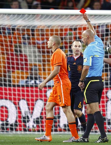 John Heitinga (left) is shown the red card by referee Howard Webb