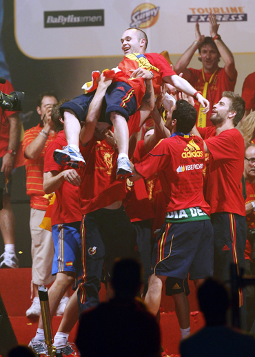 Spain's Iniesta is thrown into the air by his team-mates as they celebrate their World Cup victory