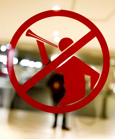 A sticker forbidding the blowing of vuvuzelas is seen on a door of a mall in Bloemfontein