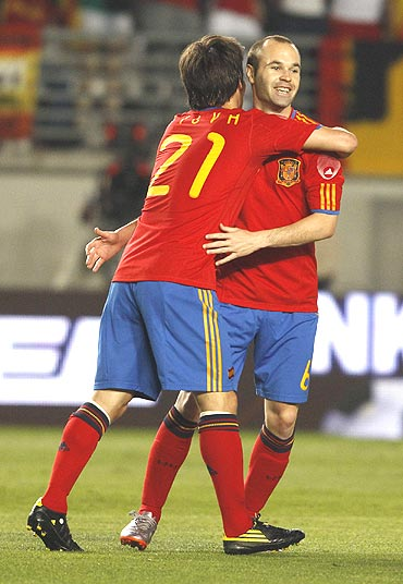 Spain's David Silva (left) celebrates with team-mate Andres Iniesta after scoring
