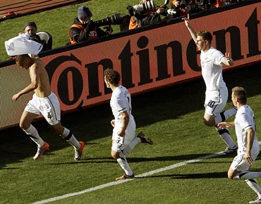 New Zealand's Winston Reid (left) takes off his jersey as he celebrates his goal with team mates