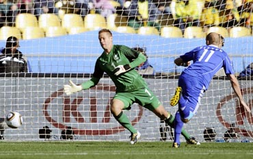 Slovakia's Robert Vittek (right) heads to score past New Zealand goalkeeper Mark Paston