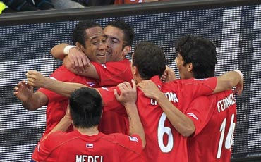 Chile players celebrate after scoring a goal