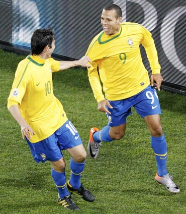 Luis Fabiano (right) celebrates with Kaka after scoring against Chile