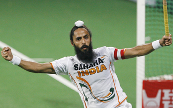 India's captain Rajpal Singh celebrates after scoring the second goal during their match against England