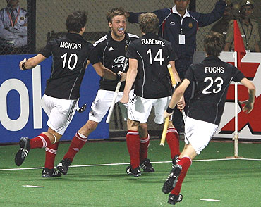 Germany's Moritz Furste (2nd from left) celebrates with team-mates after levelling the scores