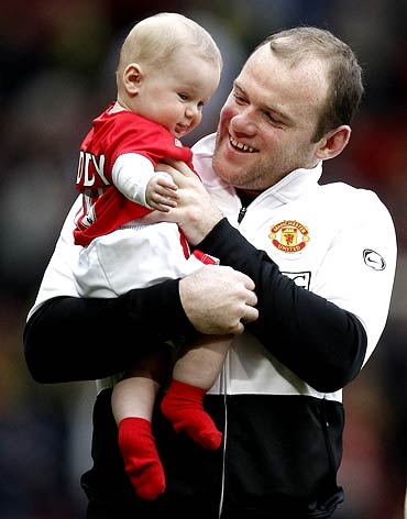 Rooney with his son Kai