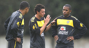 Brazilian soccer players Robinho (right), Elano (centre) and Gilberto Silva attend a practice session