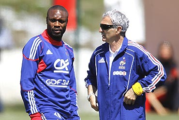 French coach Raymond Domenech (right) speaks with William Gallas