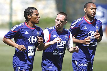 French players Florent Malouda (left) Franck Ribery (centre) and Thierry Henry go through the grind during a training session in Tignes