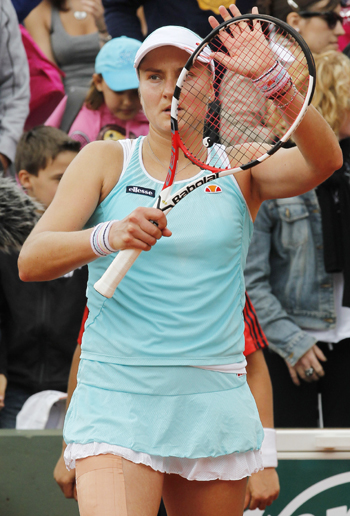 Nadia Petrova of Russia celebrates winning her match against Agnes Szavay of Hungary at the French Open tennis