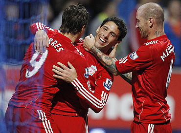 Liverpool's Maxi Rodriguez (centre) celebrates with Fernando Torres (left) and Raul Meireles (right) after scoring during against Bolton Wanderers on Sunday