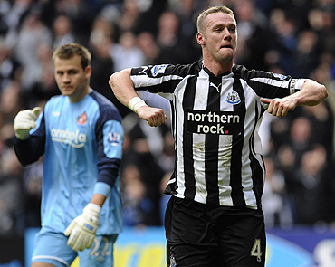 Newcastle United's Kevin Nolan (right) celebrates after scoring against Sunderland on Sunday