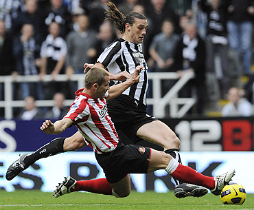 Sunderland's Phil Bardsley (right) challenges Newcastle United's Andy Carroll on Sunday