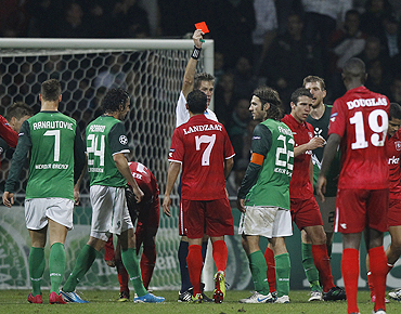 Werder Bremen's Torsten Frings (4th from right) receives a red card from referee Alain Hamer during their Champions League match against Twente Enschede on Tuesday