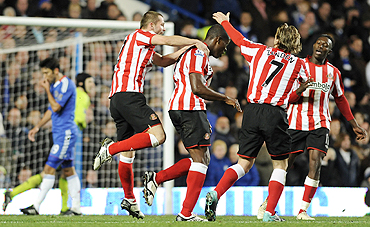 Sunderland's Nedum Onuoha is congratulated by teammates Phil Bardsley and Boudewijn Zenden after scoring against Chelsea on Sunday