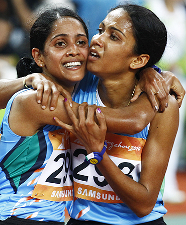 India's Preeja Sreedharan (left) celebrates winning the women's 10,000m final with compatriot and silver medallist Kavita Raut on Sunday