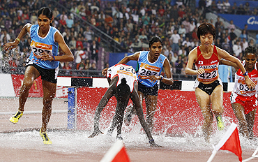 India's Sudha Singh (left) runs to claim the women's 300m steeplechase gold on Sunday