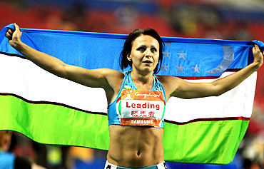 Uzbekistan's Yuliya Tarasova celebrates winning the women's heptathlon at the 16th Asian Games in Guangzhou