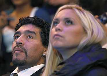 Diego Maradona watches the match at the ATP World Tour Finals in London