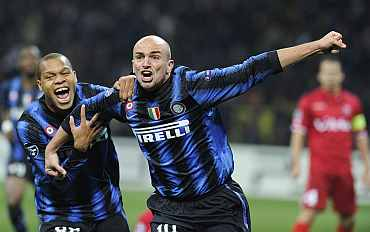 Inter Milan's Cambiasso celebrates with team-mate after scoring against Twente during their match at the San Siro