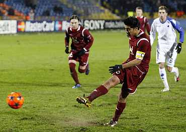 Rubin Kazan's Christian Noboa scores from a penalty during their match against FC Copenhagen