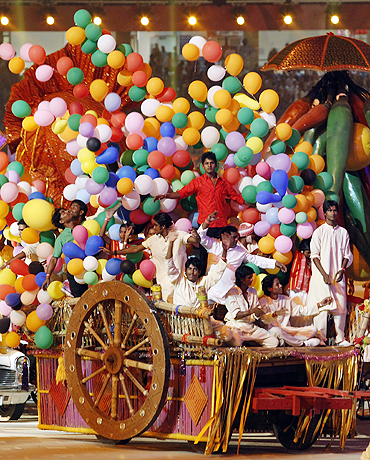Performers sit in a cart as they take part in the opening ceremony