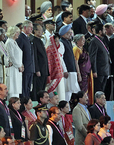 Camilla, Duchess of Cornwall, (from left to right) Britain's Prince Charles, India's President Pratibha Patil's, Patil's husband Devisingh Ramsingh Shekhawat, India's Prime Minister Manmohan Singh, Singh's wife Gursharan Kaur and Commonwealth Games Organising Committee chairman Suresh Kalmadi stand for the national anthem during the Opening Ceremony