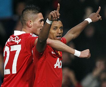 Manchester United's Nani (right) celebrates with Federico Macheda after scoring