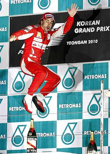 Ferrari's Fernando Alonso celebrates after winning the South Korean F1 Grand Prix